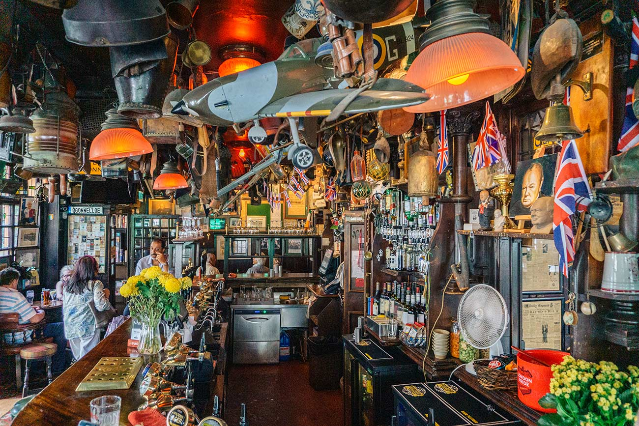 Bar at Churchill Arms Pub London with memorabilla