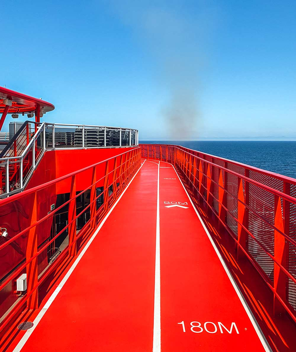 The outdoor running jogging track onboard Virgin Voyages Scarlet Lady cruise ship