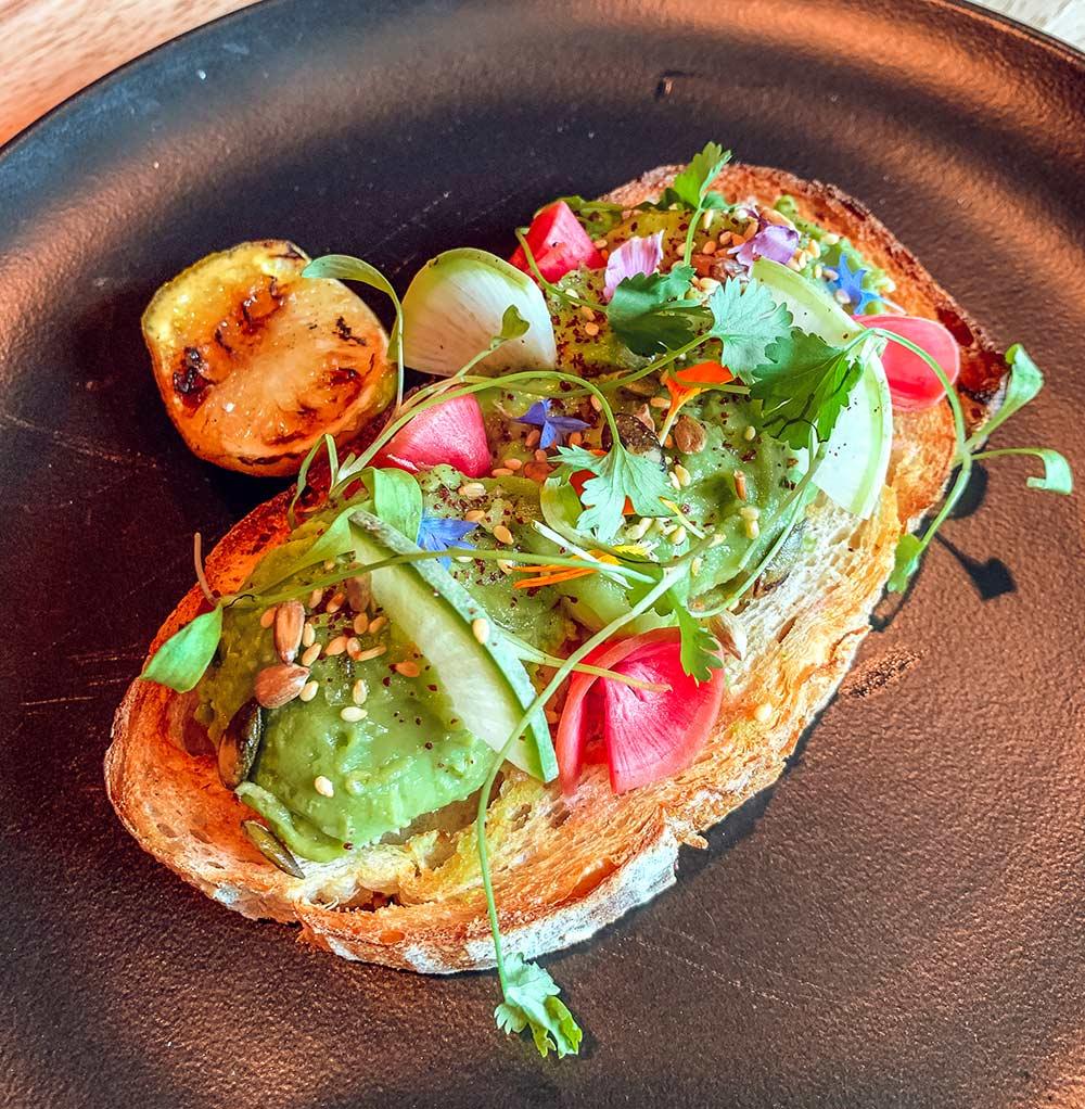 Avocado toast at Razzle Dazzle restaurant onboard Virgin Voyages Scarlet Lady cruise ship