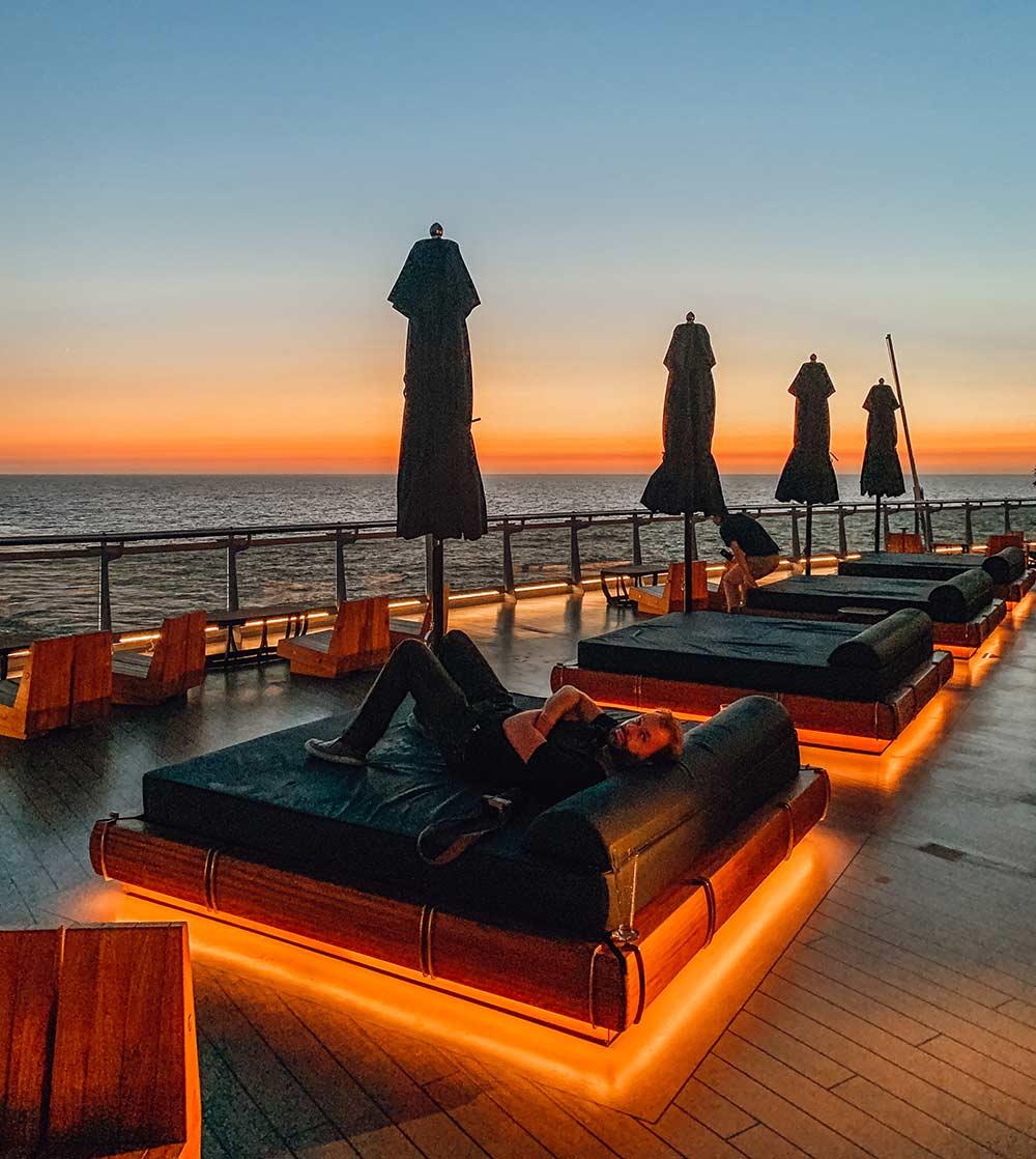 sunset bar onboard Virgin Voyages Scarlet Lady cruise ship
