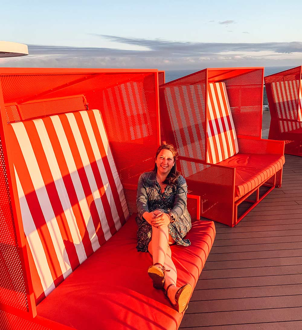 Stripey red sun chairs onboard Virgin Voyages Scarlet Lady cruise ship