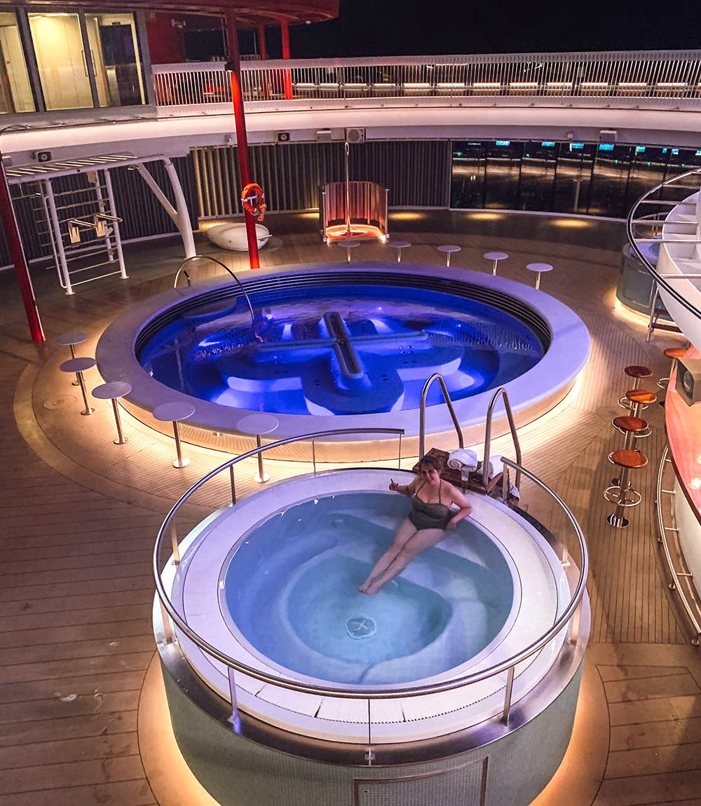 Outdoor pools and hot tubs onboard Virgin Voyages Scarlet Lady cruise ship