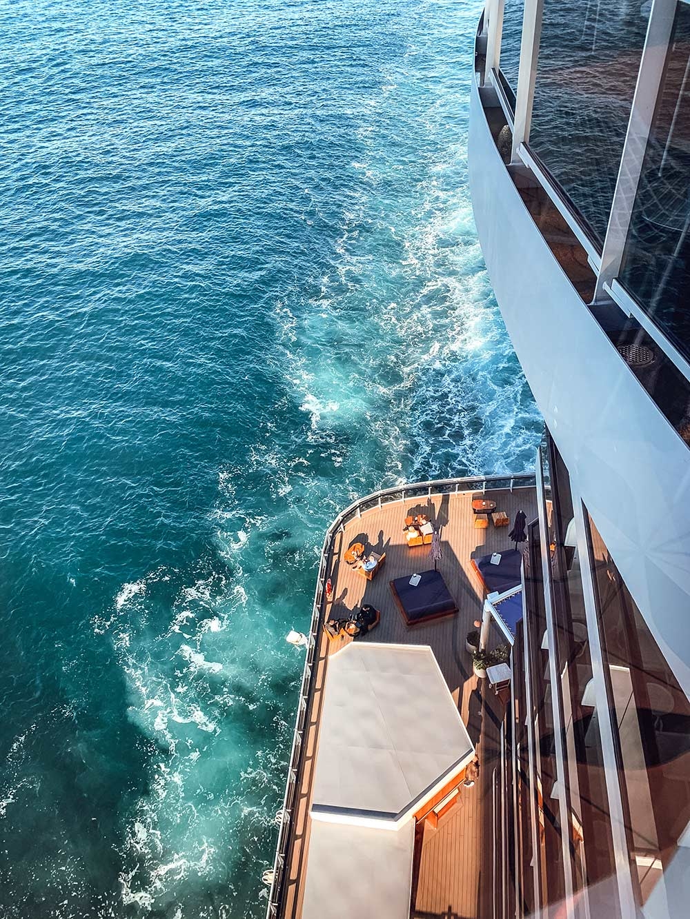 View of back of ship onboard Virgin Voyages Scarlet Lady cruise ship